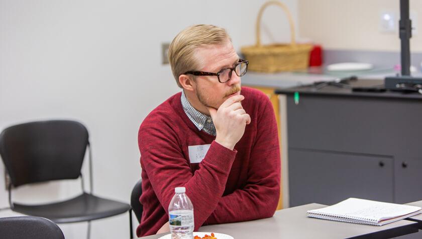 Alumnus Kyle Kleinbeck listening to current students.