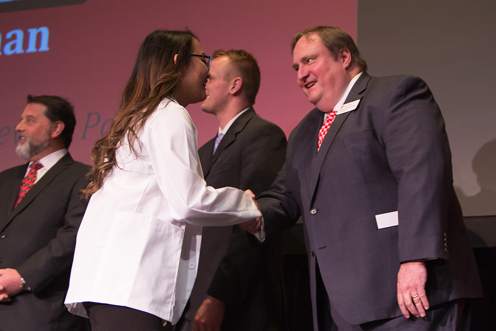 Students dress with the white coat to symbolize the achievement they have at the School.