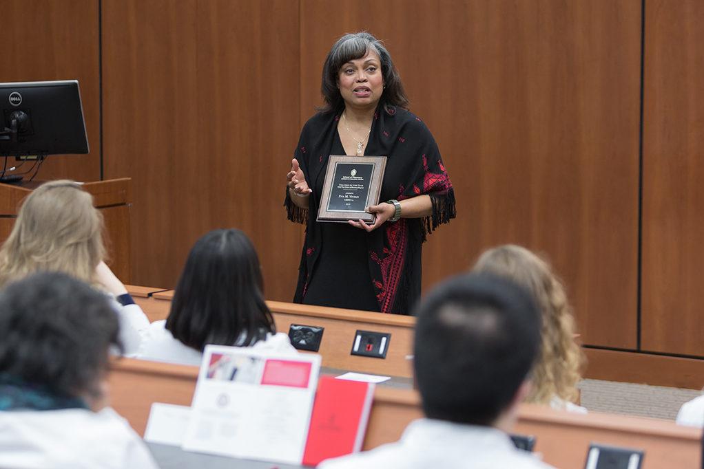 Dr. Eva Vivian presents in front of her students.