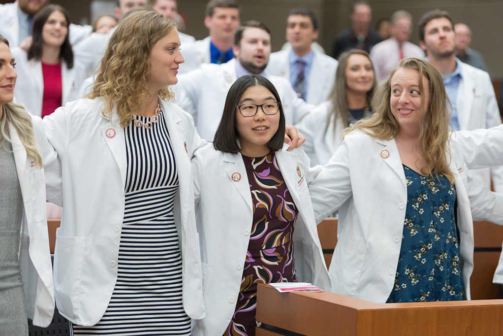 Student pharmacists are together on the ceremony.