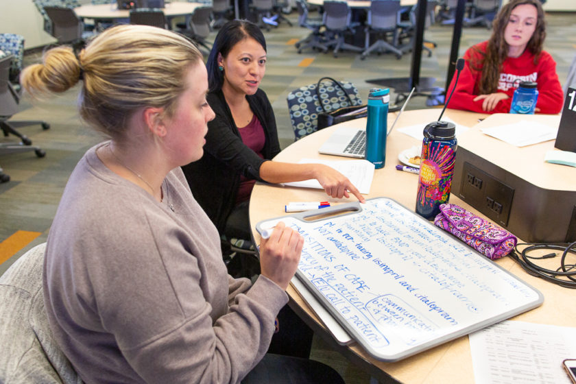 PharmD and nursing students creating a root cause analysis for a transitions of care simulation.