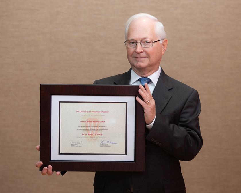 Thomas Rosanske holding his Citation of Merit award.