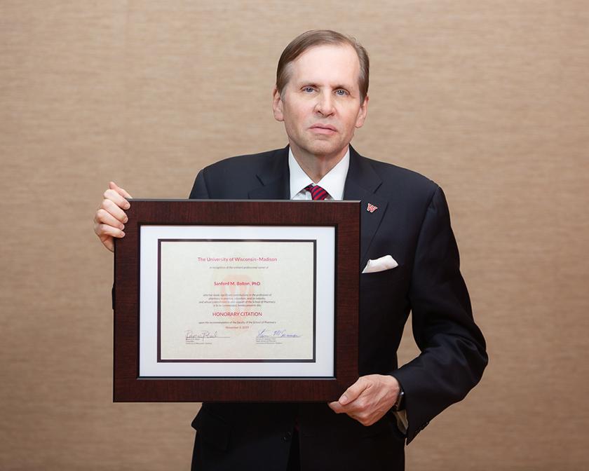Eric Goldman holding Sanford Bolton's Citation of Merit award