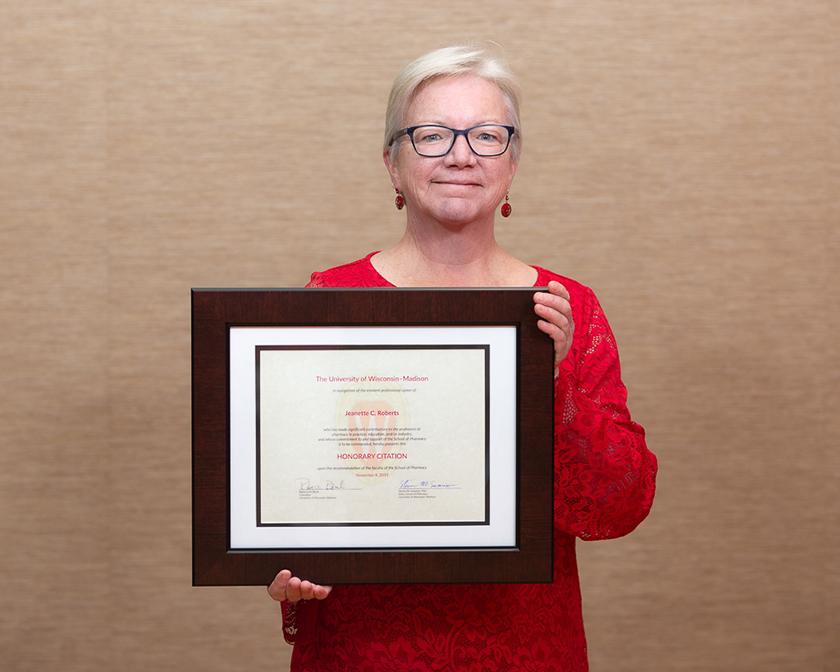 Jeanette Roberts holding her Citation of Merit award.