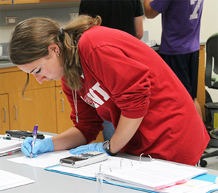 A first-year pharmacy student works on a lab exercise.
