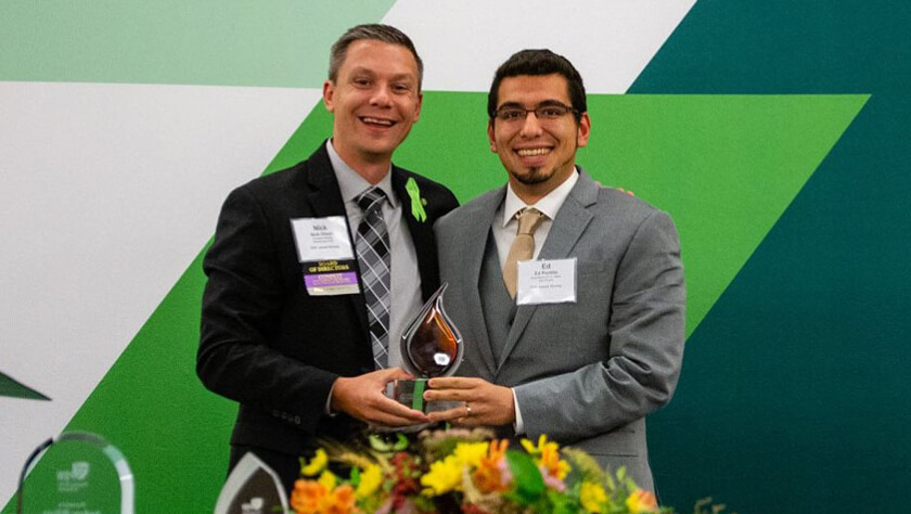 Ed Portillo accepts his Distinguished Young Pharmacist Award