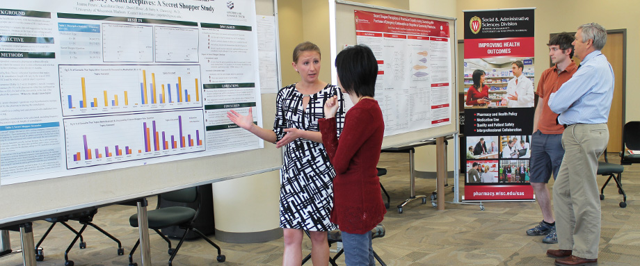 HSRP graduate students Joanne Peters and Dan Ricci present their research at a symposium.