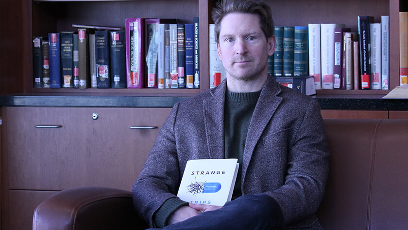 Associate Professor Lucas Richert and his new book, Strange Trips.