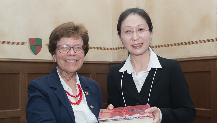 Assistant Professor Jiaoyang Jiang and Chancellor Rebecca Blank.