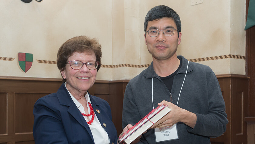 Professor Weiping Tang and Chancellor Rebecca Blank.